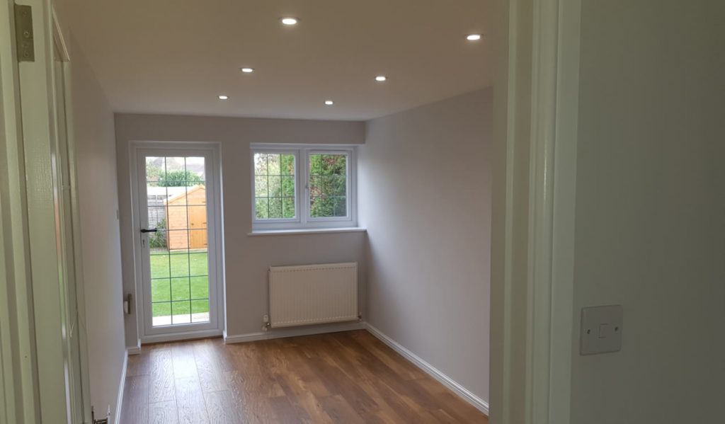 A garage conversion, by KPC Property Services, Ltd. Bedford
